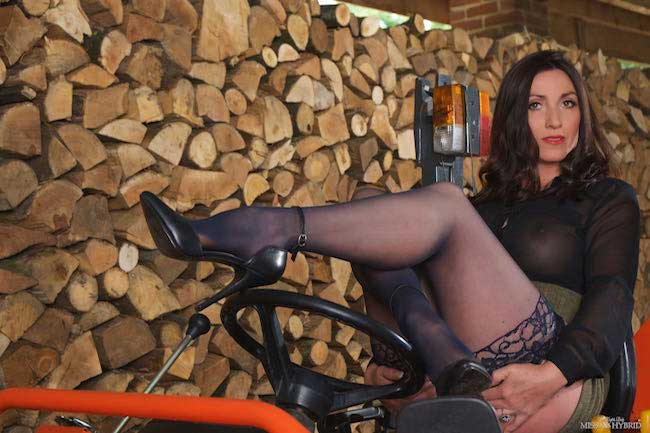 Miss Hybrid open crotch panties riding on the tractor.