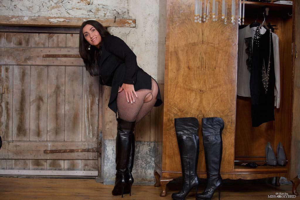 Miss Hybrid stunning in Ralph Lauren leather thigh boots, open crotch fishnets in the Manor dungeon.